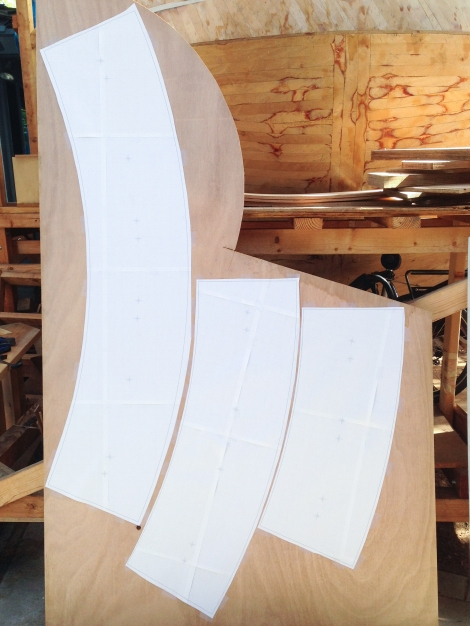 Three templates now cut out and taped to a single sheet of 1/2 inch plywood.